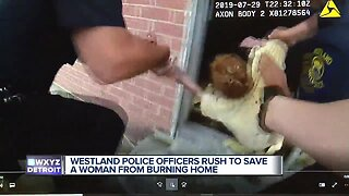 Westland police officers rush to save woman from burning home