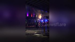 Firefighters tackle large blaze at Camden Lock Market - Video