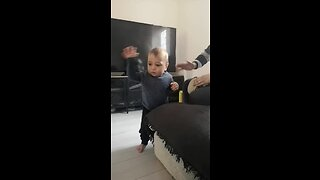Baby boy dances to dad's drum solo