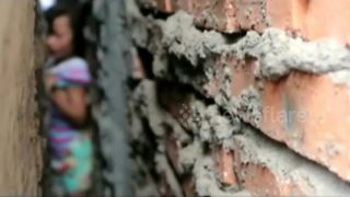 Firefighters rescue girl stuck in wall gap