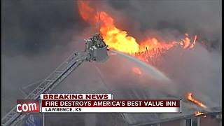 Lawrence fire crews battle motel fire - Video