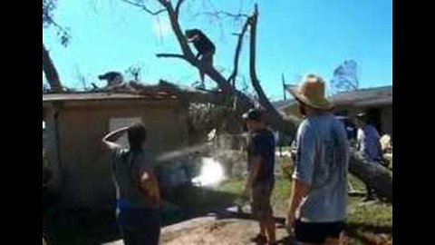 Tree Surgeons Work to Remove Debris in Panama City After Hurricane Michael