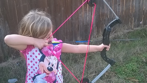 5 Year Old Girl Having Fun With Her Bow