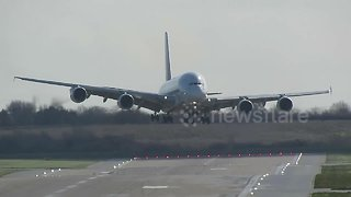 Planes struggle to land at Birmingham Airport as Britain is battered by gale-force winds - Video