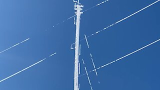 Massive chunks of ice fall from 650 foot communications tower