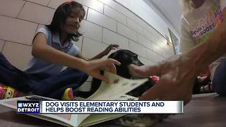 Dog visits elementary students and helps boost reading abilities