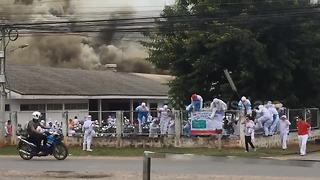 Workers run for their lives as huge fire rips through grilled chicken factory - Video