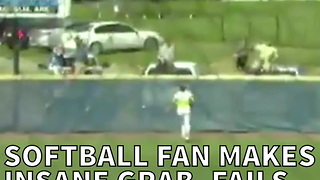 Softball Fan Makes Insane Grab, Fails To Finish The Play - Video