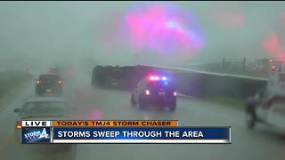 Strong winds tip over semi in Sheboygan County - Video