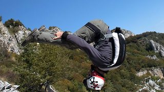 Moment base jumper flips eight times in five seconds during incredible jump - Video
