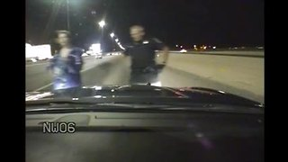 Woman trying to run into traffic saved twice by troopers - Video