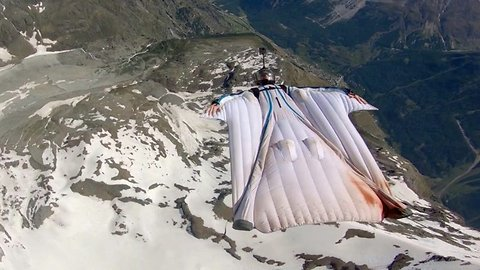 Don't look down (literally): daring wingsuit pilot soars through the air upside down, not even looking at the ground below