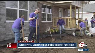 Students, volunteers finish building home in Drexel Gardens