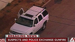 Suspects and police exchange gunfire - Video