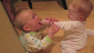 """""""Two Baby Boys in Footie Pajamas Fight Over Pacifier"""""""