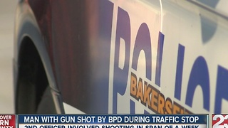 Man with rifle shot by police at traffic stop - Video
