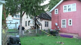 Fire crews rescue child from roof of house fire