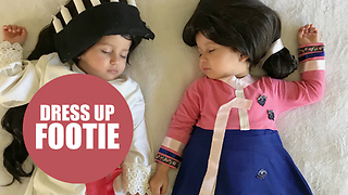 Mother hand makes her twins costumes ready for the WORLD CUP - Video
