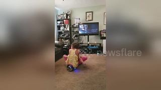 Little girl and baby brother smash into TV on hoverboard - Video