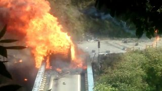 Video shows cylinders bursting into flames as truck carrying them catches fire - Video