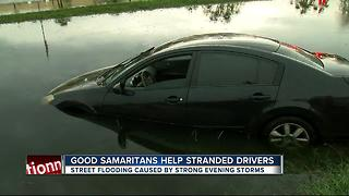 Good Samaritans help stranded drivers from street flooding