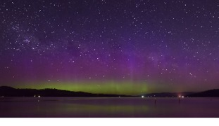 Timelapse Captures Shooting Stars Streaking Over Aurora-Filled Night Sky - Video