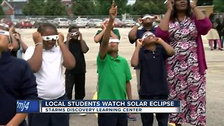 Students at Starms study solar eclipse for class project - Video