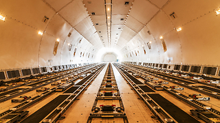 There are cargo planes out there big enough to freight cars or even spaceship parts. How are these massive planes made? - Video