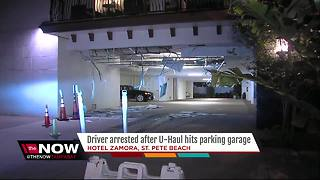 Driver arrested after UHaul collides with hotel parking garage - Video