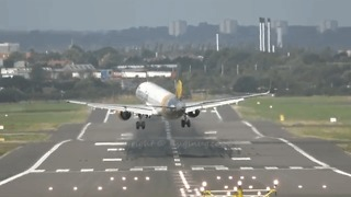 Plane Caught In Crosswind Forced To Miss Landing - Video