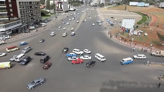 Drivers Navigate Chaotic Intersection In Ethiopia - Video