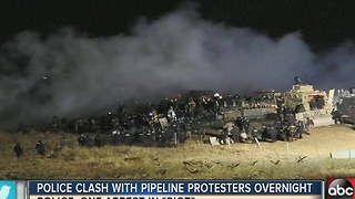 Police clash with pipeline protesters overnight - Video