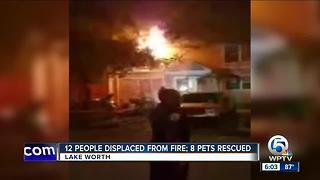 12 people displaced from fire, 8 pets rescued - Video
