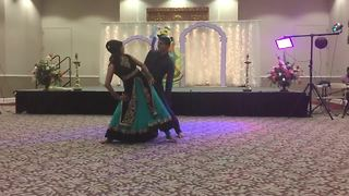 Bride and brother pull off epic wedding dance routine - Video
