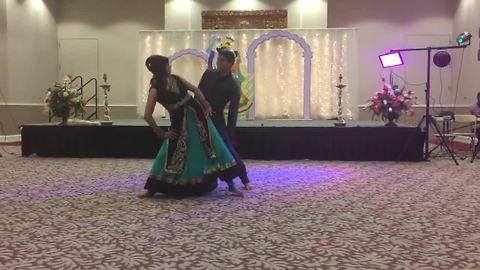 Bride and brother pull off epic wedding dance routine