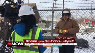 DTE workers repair blown transformer in bitter cold
