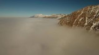 Drone Flies Above the Smoggy Winter Inversion at Ogden - Video