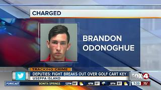 Two get into fight over golf cart key - Video