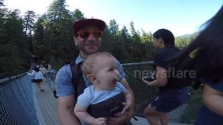 Baby has the time of his life crossing the Capilano Suspension bridge - Video