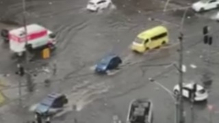 Pedestrians and Cars Struggle Through Melbourne Floodwaters
