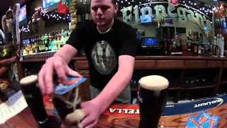 Bartender's Impressive Guinness Flipping Trick - Video