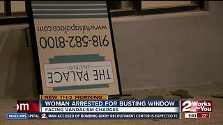 Woman arrested for busting a window at The Palace Apartments - Video