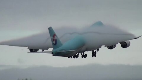 Incredible amount of condensation forms around airplane on takeoff