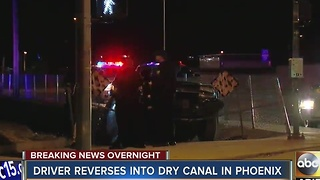 Driver reverses into dry canal in Phoenix - Video