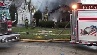 Crews battling house fire in Royal Oak - Video