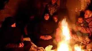 Aleppo Civilians Huddle Around Makeshift Fires in Freezing Cold - Video