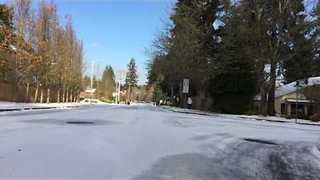 Watch a Sledding Adventure on a Snow-Covered Oregon Street - Video