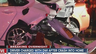Driver charged with DWI after crashing into car, house - Video