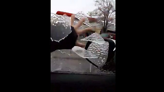Frozen Rain Forms Ice Sheets To Replace Car Windows  - Video