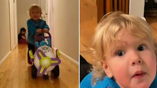 Running toddler wipes out after crashing his toy airplane